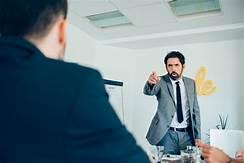 boss reprimanding staff